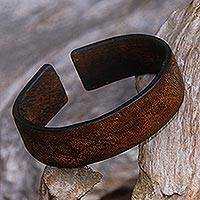 Leather cuff bracelet, 'Hidden Stars' - Handmade Leather Cuff Bracelet with Star Engraving from Bali