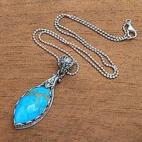 Gold accented turquoise pendant necklace,