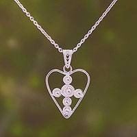 Sterling silver filigree pendant necklace, 'Heart Stars' - Sterling Silver Filigree Heart Necklace from Java