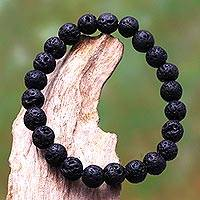 Lava stone beaded stretch bracelet, 'Planet Craters' - Lava Stone Beaded Stretch Bracelet from Bali