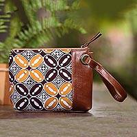 Leather accented batik cotton wristlet, 'Marvelous Kawung' - Kawung Motif Leather Accented Batik Cotton Wristlet