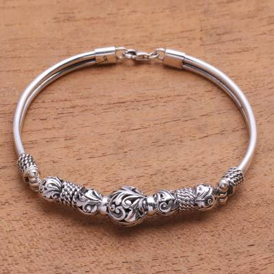 Sterling silver bangle bracelet, 'Tegalalang Garden' - Leaf Motif Sterling Silver Bangle Bracelet from Java