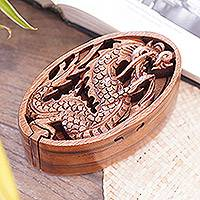 Wood puzzle box, 'Dragon Oval' - Dragon-Themed Suar Wood Puzzle Box from Bali