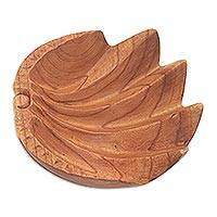 Suar wood catchall, 'Secure' (7.5 inch) - Suar Wood Clam Shell Motif Hand Carved Catchall from Bali