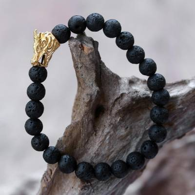 Gold accented lava stone beaded stretch bracelet, 'Calm Dragon' - Lava Stone Dragon Beaded Stretch Bracelet with Gold Accent