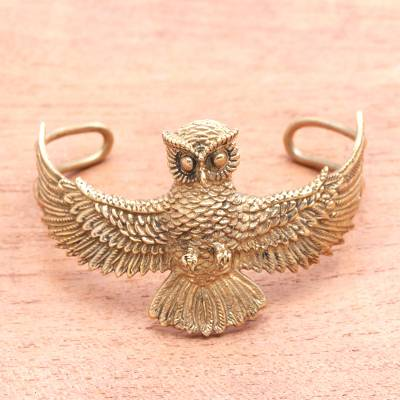 Brass cuff bracelet, 'Flying Owl' - Owl-Themed Brass Cuff Bracelet from Indonesia