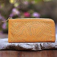 Leather clutch, 'Scattered Stars in Amber' - Floral Pattern Leather Clutch in Amber from Bali