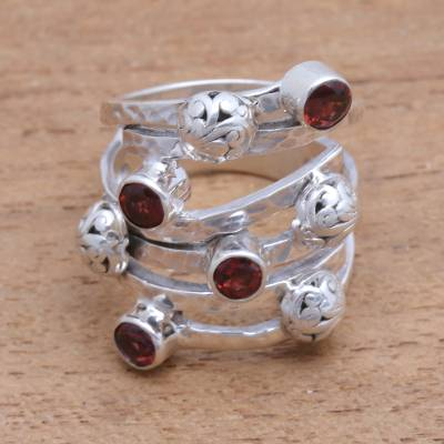 Garnet cocktail ring, 'Exuberant Beauty' - Handcrafted Wide Sterling Silver and Garnet Ring from Bali