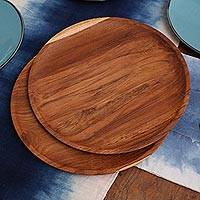 Teakwood plates, 'Natural Appetite' (14 inch, pair) - Handmade Natural Teakwood Plates from Bali (14 Ine, Pair)