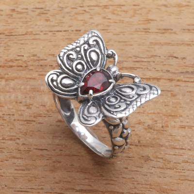 Garnet cocktail ring, 'Chosen Butterfly' - Faceted Garnet Butterfly Cocktail Ring from Bali