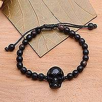 Beaded horn and wood pendant bracelet, 'Dark Visage' - Black Horn Skull Beaded Pendant Bracelet
