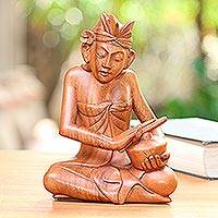 Wood sculpture, 'Riong Player' - Suar Wood Riong Gong Player Sculpture