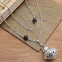 Garnet and peridot harmony ball necklace, 'Plumeria Chime' - Silver & Garnet Plumeria Harmony Ball Necklace with Peridot