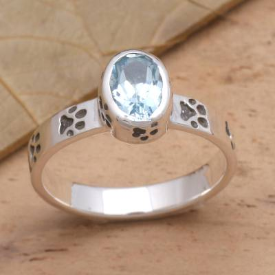 Blue topaz single-stone ring, 'Pawprints' - Faceted Blue Topaz Sterling Silver Ring with Pawprint Motif