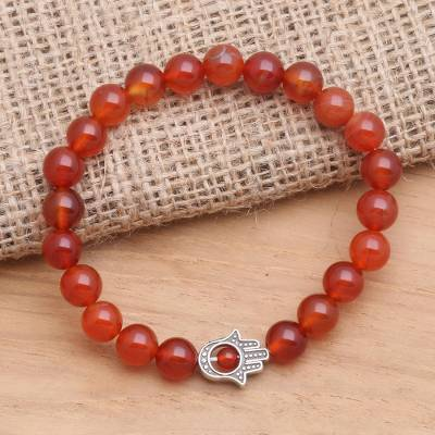 Carnelian beaded stretch bracelet, 'Hamsa Hand in Scarlet' - Carnelian Beaded Stretch Bracelet with Hamsa Hand