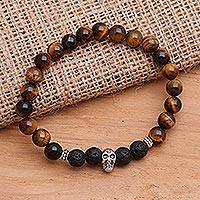 Tiger's eye and onyx beaded stretch bracelet, 'Staring Skull in Brown' - Tiger's Eye Stretch Beaded Bracelet with Sterling Skull
