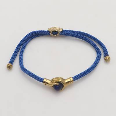 Brass and blue agate unity bracelet, 'Golden Hands' - Bali Brass and Blue Agate Cord Unity Bracelet
