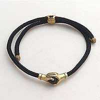 Brass and obsidian unity bracelet, 'Golden Handshake' - Brass and Black Obsidian Cord Unity Bracelet from Bali