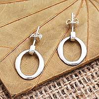 Sterling silver dangle earrings, 'Oval Track' - Sterling Silver Post Earrings with Dangling Circles