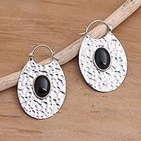 Onyx hoop earrings, 'Oval Shadow' - Hammered Sterling Silver Oval Hoop Earrings with Black Onyx