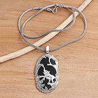 Sterling silver and lava stone pendant necklace, 'Elephant Habitat' - Sterling Silver and Lava Stone Elephant Pendant Necklace