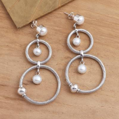 Cultured pearl dangle earrings, What Goes Around