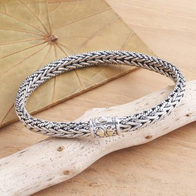 Gold-accented sterling silver bracelet, 'Well Known' - Handmade Sterling Silver and Gold Accented Braided Bracelet