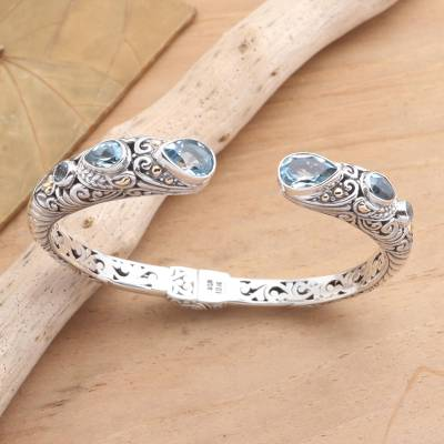 Gold accented blue topaz cuff bracelet, 'Fierce Warrior in Blue' - Sterling Silver and Blue Topaz Cuff Bracelet from Bali