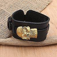 Unisex leather and brass wristband bracelet, 'Strapped' - Handmade Leather and Brass Skull Wristband Bracelet