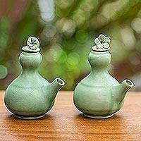 Ceramic oil and vinegar set, 'Happy Frangipani' (pair) - Ceramic Oil And Vinegar Set (Pair)