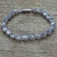 Topaz tennis bracelet, 'Sparkling Blue River' - Sterling Silver Link Blue Topaz Bracelet from India