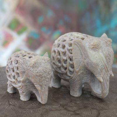 Soapstone sculptures, 'Elephant Duet' (set of 2) - Hand Carved Soapstone Jali Sculptures (Pair)
