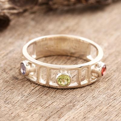 Garnet and peridot 3 stone ring