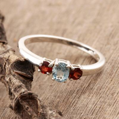 Garnet and blue topaz 3-stone ring, 'Passionate Embrace' - Blue Topaz and Garnet Ring