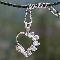 Blue topaz heart necklace, 'Winged Heart' - Blue Topaz Heart Necklace