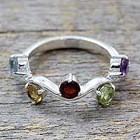 Garnet and blue topaz cocktail ring, 'Tropical Flowers' - Five Gemstone Sterling Silver Cocktail Ring from India