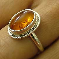 Amber solitaire ring, 'Illumine' - Amber Cocktail Ring from India Sterling Silver Jewelry