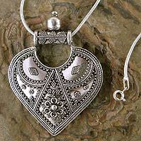 Sterling silver pendant necklace, 'Mighty Heart' - Heart-Shaped Sterling Silver Pendant from India