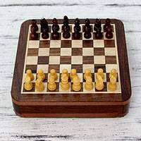 Wood travel chess set, 'Brave Warrior' - Hand Carved Wood Magnetic Travel Chess Set and Storage Box