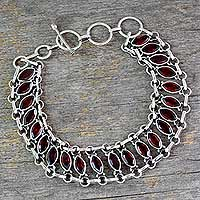 Garnet wristband bracelet, 'Eyes of Passion' - Garnet Wristband Bracelet in Sterling Silver Jewelry