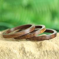 Wood bangle bracelets, 'Forest Dancer' (set of 3) - Wood Bangle Bracelets Hand Carved in India (Set of 3)
