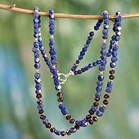 Lapis lazuli and garnet strand necklace,