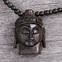 Ebony pendant necklace, 'Peaceful Buddha' - Fair Trade Wood Pendant Necklace