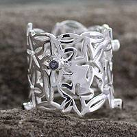 Sterling silver flower ring, 'Bouquet of Stars' - Wide Band Ring in Sterling Silver and Quartz from India