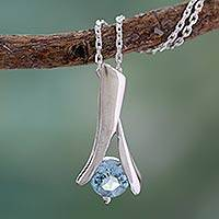 Blue topaz pendant necklace, 'Silver Flare' - Indian Sterling Silver and Blue Topaz Necklace