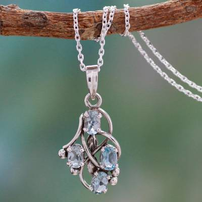 Blue topaz pendant necklace, 'Twirling' - Blue Topaz and Sterling Silver Necklace India Jewelry