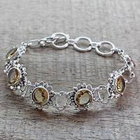 Citrine flower bracelet, 'Hindu Sunflowers' - Floral Linked 11.5k Citrine and Sterling Silver Bracelet