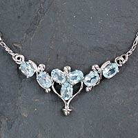 Blue topaz pendant necklace, 'Azure Radiance' - Rhodium Plated Silver and Blue Topaz Pendant Necklace