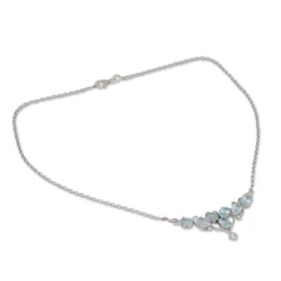 Rhodium Plated Silver and Blue Topaz Pendant Necklace