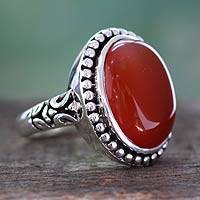 Onyx cocktail ring, 'Glowing Sunset' - Enhanced Red Onyx and Sterling Silver Cocktail Ring